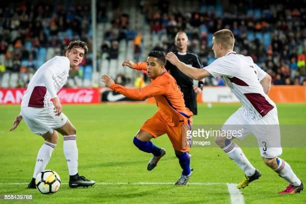 Fjordorovs Vladislavs of Jong Letland Justin Kluivert of Jong Oranje Litvinskis Viktors of Jong Letland during the EURO U21 2017 qualifying match...