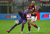 FKhouma El Babacar of ACF Fiorentina competes for the ball with Alex Dias da Costa of AC Milan during the Serie A match between AC Milan and ACF...