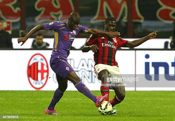FKhouma El Babacar of ACF Fiorentina competes for the ball with Cristian Zapata of AC Milan during the Serie A match between AC Milan and ACF...
