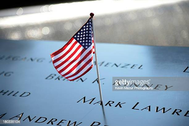A flag adorns the 9/11 Memorial on the twelfth anniversary of the terrorist attacks on lower Manhattan at the World Trade Center site on September 11...