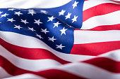 USA flag. American flag. American flag blowing wind. Close-up. Studio shot.USA flag. American flag. American flag blowing wind. Close-up. Studio shot.
