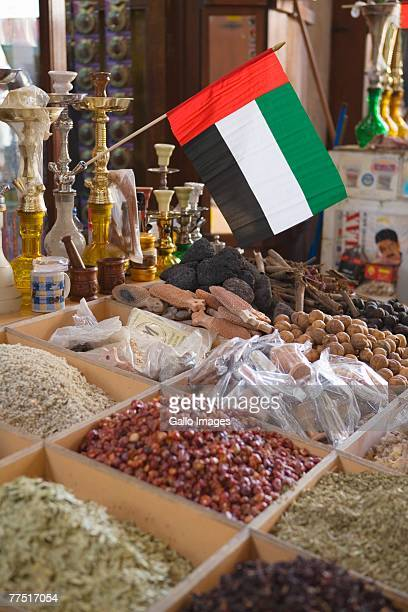 UAE flag and spices in spice souq, Deira, UAE. United Arab Emirates