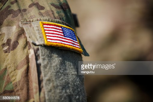 USA flag and US Army patch on solder's uniform : Stock Photo