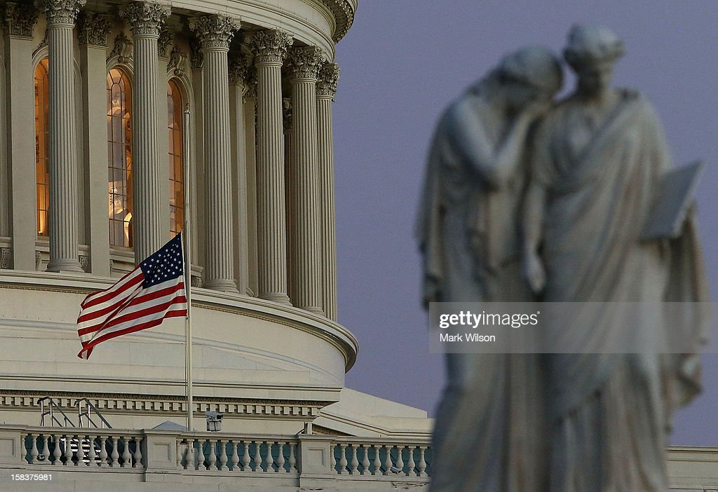 A flag at the U.S. Capitol flies at half staff after President Barack Obama ordered the action while speaking on the shootings at the Sandy Hook Elementary School December 14, 2012 in Washington, DC. Obama called for 'meaningful action' in the wake of the latest school shooting that left 27 dead, including 20 children.