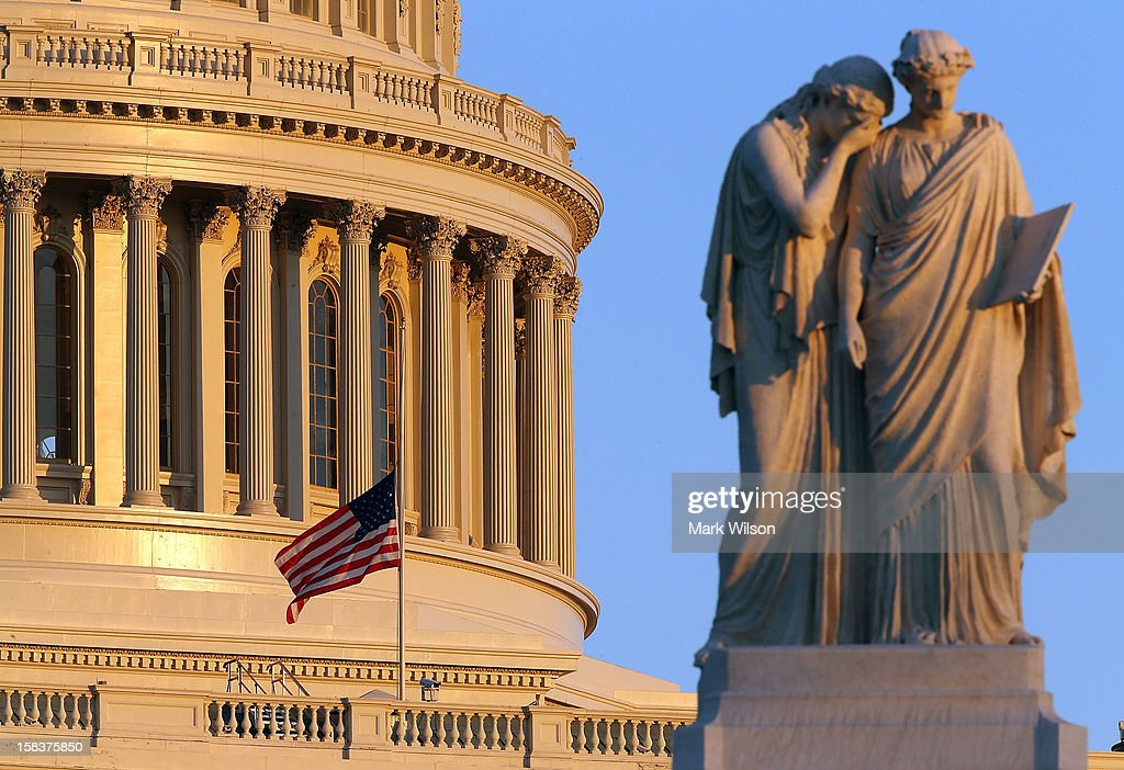 A flag at the U.S. Capitol has been lowered to half staff after President Barack Obama ordered the action while speaking on the shootings at the Sandy Hook Elementary School December 14, 2012 in Washington, DC. Obama called for 'meaningful action' in the wake of the latest school shooting that left 27 dead, including 20 children.
