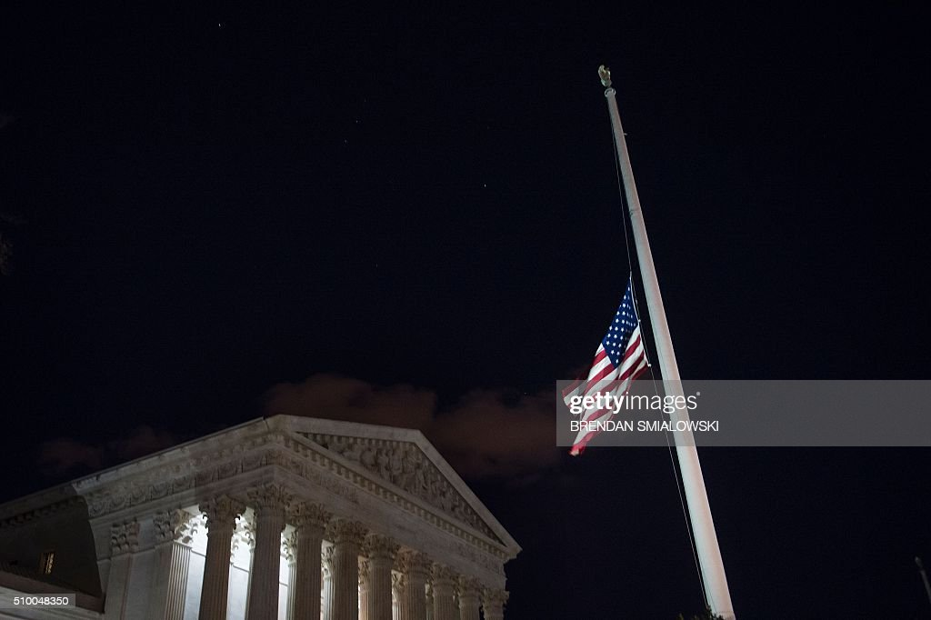A flag at the US Supreme Court is lowered to half staff February 13, 2016 in Washington, DC, following the announcement of the death of Supreme Court Justice Antonin Scalia. Scalia, a fiery conservative who helped shape American legal thought, was first appointed to the highest court in the land in 1986 by President Ronald Reagan, making him the first Italian-American to serve there. Scalia was 79. / AFP / Brendan Smialowski