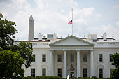 A flag atop White House flies at halfstaff in honor of Beau Biden on June 6 in Washington DC President Obama is traveling to Wilmington Delaware to...