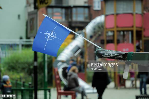 A NATO flag attached to the end of the muzzel of a Howitzer artillery piece is seen during NATO day in Bydgoszcz Poland on October 14 2017