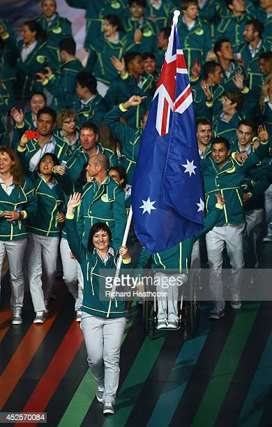 Flag bearer and Cyclist Anna Meares of Australia waves during the Opening Ceremony for the Glasgow 2014 Commonwealth Games at Celtic Park on July 23...