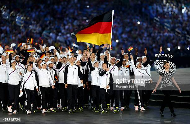 flag bearer and gymnast Fabian Hambuechen of Germany leads his team into the stadium during the Opening Ceremony for the Baku 2015 European Games at...