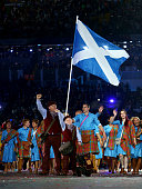 Flag bearer and Judoka Euan Burton of Scotland leads the Scottish athletes during the Opening Ceremony for the Glasgow 2014 Commonwealth Games at...