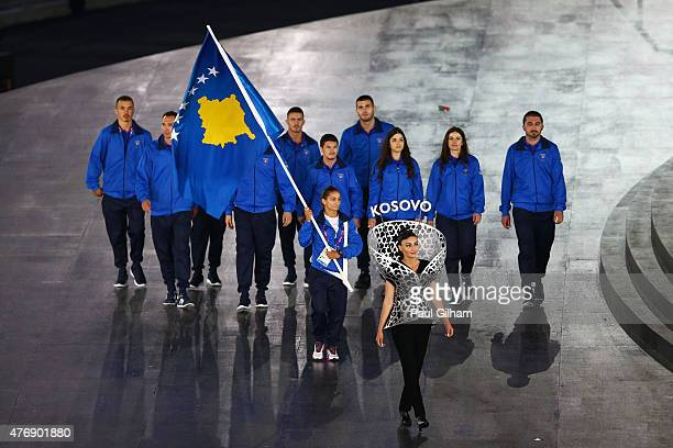 Flag bearer and judoka Majlinda Kelmendi of Kosovo leads her team into the stadium during the Opening Ceremony for the Baku 2015 European Games at...