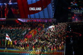 Flag bearer and Squash player Nick Matthew of England leads the England athletes during the Opening Ceremony for the Glasgow 2014 Commonwealth Games...