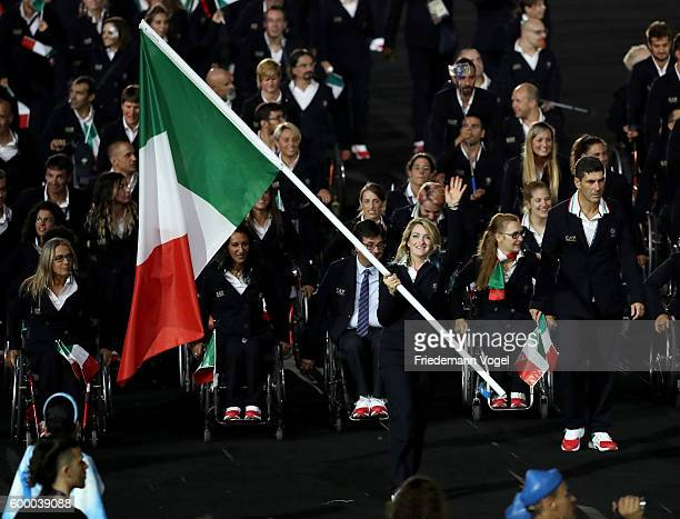 Flag bearer Martina Caironi of Italy leads the team entering the stadium during the Opening Ceremony of the Rio 2016 Paralympic Games at Maracana...