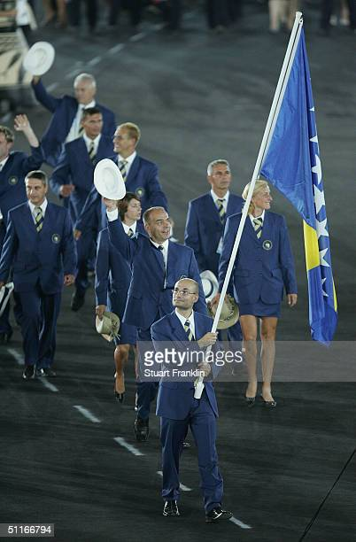 Flag bearer Nedzad Fazlija leads the delegation from Bosnia Herzegovina as they walk during the parade of nations part of the opening ceremonies for...