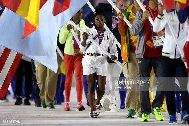 Flag bearer Simone Biles of United States walks during the 'Heroes of the Games' segment during the Closing Ceremony on Day 16 of the Rio 2016...