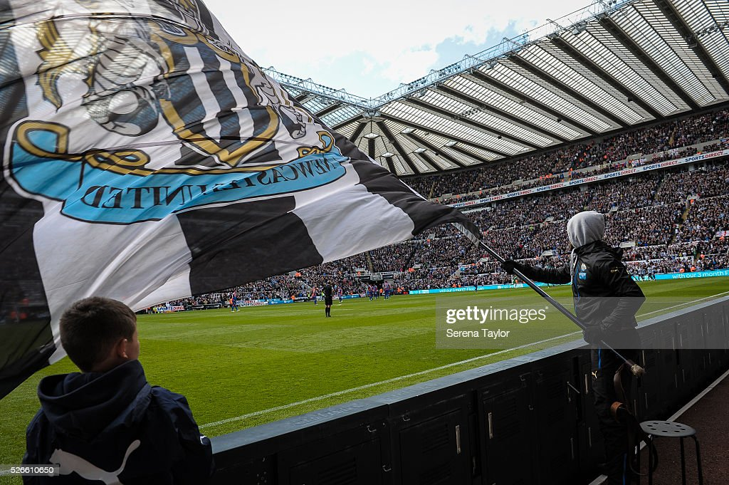 A Flag bearer waves his flag after Andros Townsend (hidden) scored the opening goal during the Barclays Premier League match between Newcastle United and Crystal Palace at St.James' Park on April 30, 2016, in Newcastle upon Tyne, England.
