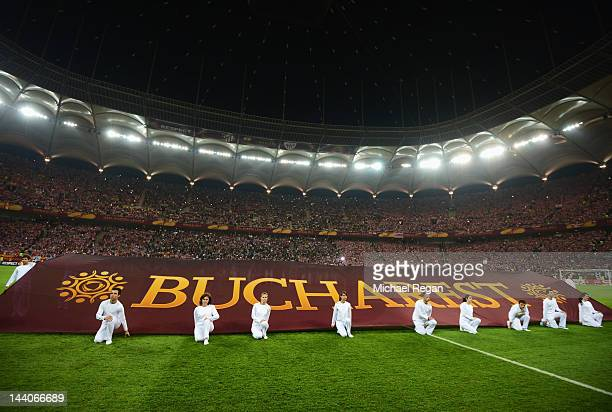 Flag bearers display a flag honouring the host city prior to the UEFA Europa League Final between Atletico Madrid and Athletic Bilbao at the National...