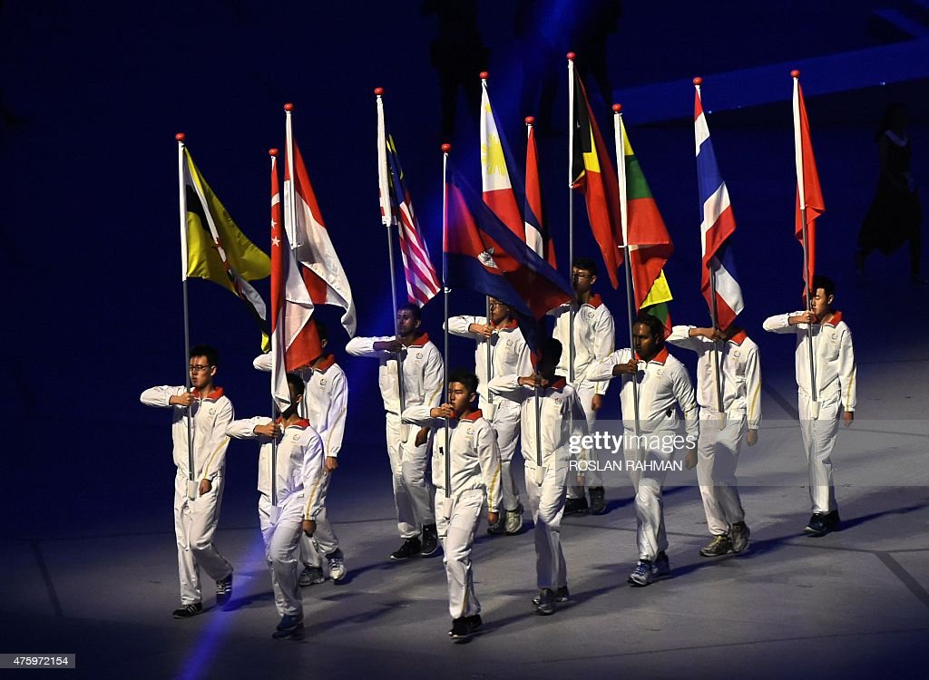 Flag bearers from the 11 ASEAN countries march during the opening ceremony of the biennial Southeast Asian Games in Singapore's National Stadium on...