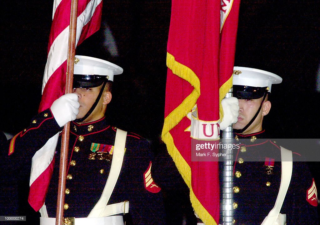 Flag bearers marching the Marine Corp Parade Honoring the Gold Star Wives of America.