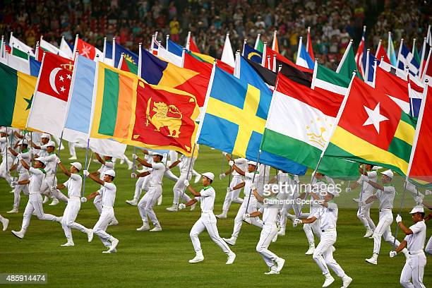Flag bearers perform during the closing ceremony during day nine of the 15th IAAF World Athletics Championships Beijing 2015 at Beijing National...
