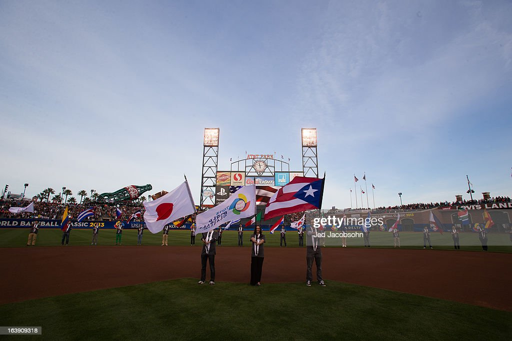 Flag bearers take the field during pre-game ceremonies before the semi-final game between Team Puerto Rico and Team Japan in the championship round of the 2013 World Baseball Classic on Sunday, March 17, 2013 in San Francisco, California.