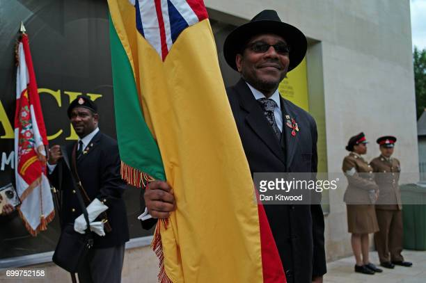 Flag bearers wait ahead of the unveiling of a memorial honoring the two million African and Caribbean military servicemen and women who served in...