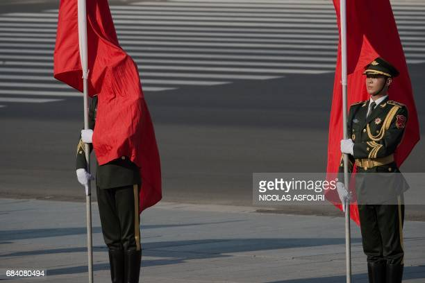 Flag bearers wait for the start of a welcome ceremony for Argentine President Mauricio Macri outside the Great Hall of the People in Beijing on May...