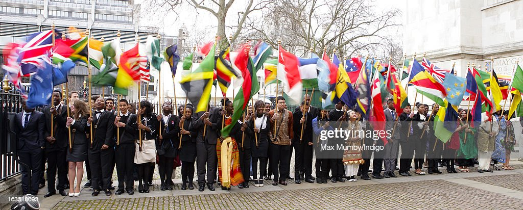Flag bearers wave the flags of The Commonwealth outside Westminster Abbey after The Commonwealth Day Observance on March 11, 2013 in London, England. Queen Elizabeth II, who is the head of the Commonwealth, was due to attend the event, but cancelled as she continues her recovery after a brief illness. Commonwealth Day Observance takes place annually on the second Monday in March, and this year's theme is 'Opportunity Through Enterprise'.