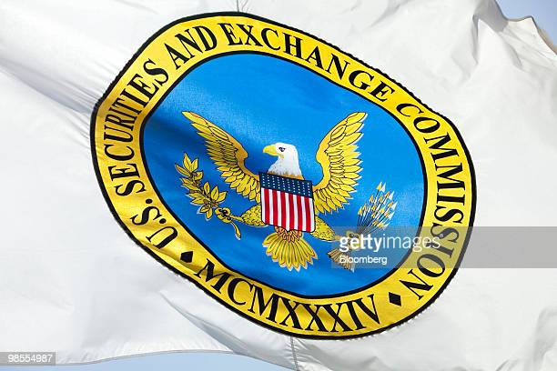 A flag bearing the logo of the US Securities and Exchange Commission waves outside the agency's headquarters in Washington DC US on Monday April 19...