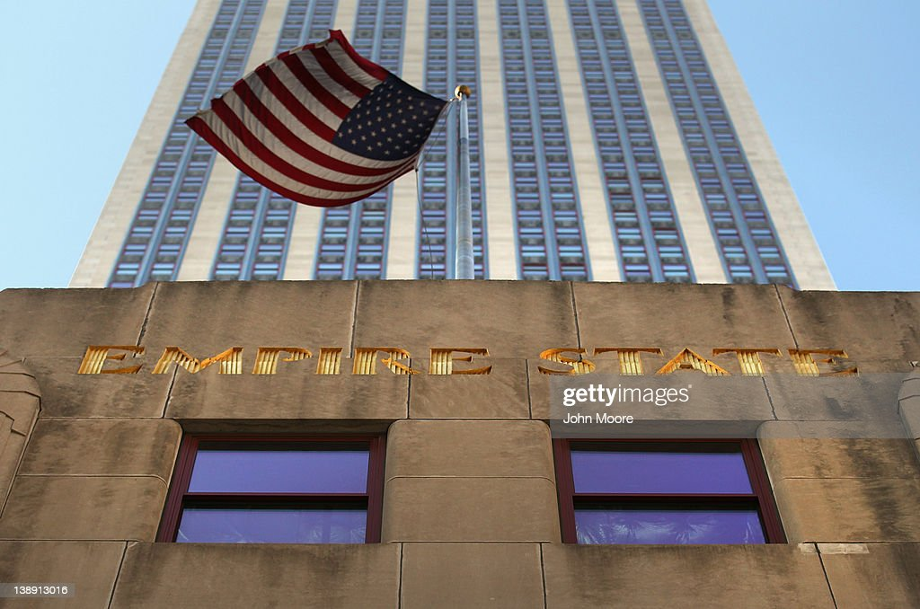 A flag blows in the wind in front of the Empire State Building on February 13, 2012 in New York City. The owner of the Empire State Building, Malkin Holdings, plans to raise up to $1 billion in an initial public offering on the 102 story Manhattan landmark.