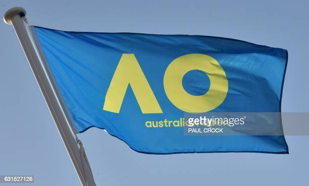 A flag carrying the new livery of the Australian Open tennis tournament flies in Melbourne on January 12 2017 / AFP / PAUL CROCK