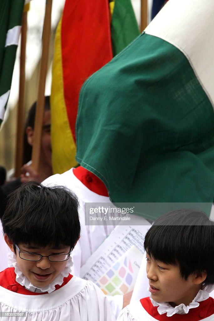 A flag covers the face of one of the choir boys as he waits for Prince Philip, Duke Of Edinburgh to leave the Commonwealth Day Observance at Westminster Abbey on March 11, 2013 in London, England.
