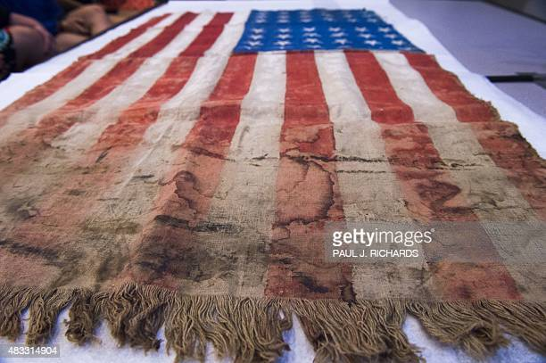 US flag created by prisoners of the WWII Langenstein concentration camp 70 years ago is seen August 7 2015 during ceremonies while surviving family...