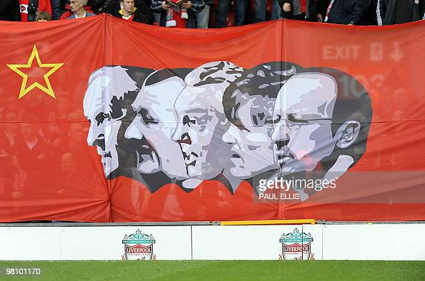 A flag depicting Liverpool managers past and present is seen below a protest banner against the club's American owners during their English Premier...