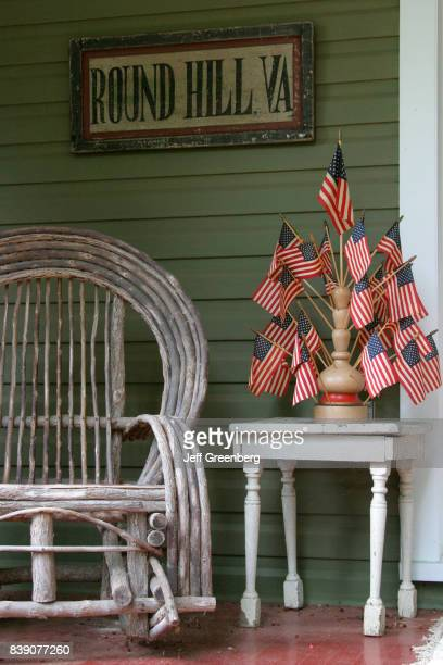 A US flag display outside a house in Round Hill