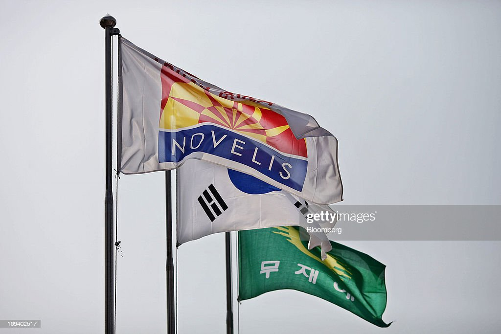 A flag displaying the Novelis Inc. logo flies above the company's production facility in Yeongju, South Korea, on Thursday, May 23, 2013. Novelis plans to boost research and development staff by 40 percent as the biggest supplier of flat-rolled aluminum products to global carmakers seeks to increase recycled content in products used in cans and vehicles. Photographer: Woohae Cho/Bloomberg via Getty Images