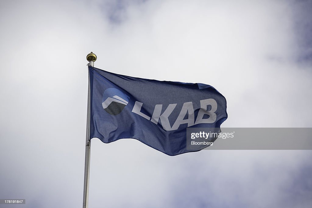 A flag displays the logo of LKAB, Sweden's state-owned mining company, as it flies outside an iron ore mine in Svappavaara near Kiruna, Sweden, on Thursday, Aug. 22, 2013. Swedes living in the Arctic town of Kiruna are packing up their belongings before their homes are bulldozed to make way for iron ore mining driven by Chinese demand. Photographer: Casper Hedberg/Bloomberg via Getty Images