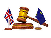flag EU and  Great Britain and wooden gavel on white background. Isolated 3D image.