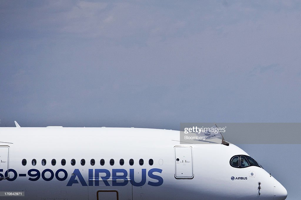 A flag flies above the cockpit of an Airbus SAS A350, produced by a unit of European Aeronautic, Defence & Space Co. (EADS), as it stands on the runway following its first flight in Toulouse, France, on Friday, June 14, 2013. Airbus SAS's new A350 wide-body returned from its maiden flight after a four-hour airborne test of the long-range airliner, in a show of confidence that the jet can enter service in late 2014 and challenge Boeing Co. Photographer: Balint Porneczi/Bloomberg via Getty Images
