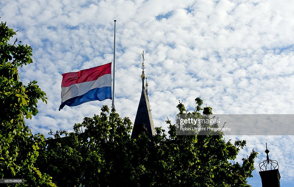 A flag flies at half mast as the Dutch government declares a national day of mourning to commemorate the victims of Malaysian Airlines flight MH17, on July 23, 2014 in The Hague, Netherlands. Flight MH17 was travelling from Amsterdam to Kuala Lumpur when it crashed killing all 298 on board including 80 children. The aircraft was allegedly shot down by a missile and investigations continue over the perpetrators of the attack.