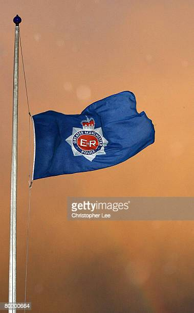 A flag flies at half mast outside of Greater Manchester Police Force Headquarters Chester House in memory of Chief Constable Michael Todd on March 11...