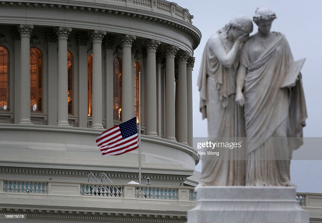 S flag flies at half staff on the US Capitol April 15 2013 on Capitol Hill in Washington DC Speaker of the House Rep John Boehner has ordered to...