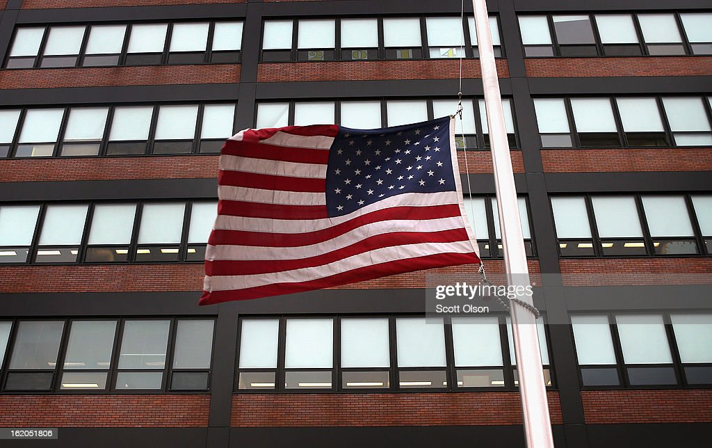 A flag flies at half-mast outside Roberto Clemente High school as a tribute to eighteen-year-old student Frances Colon on February 18, 2013 in Chicago, Illinois. Colon, who was shot and killed on Friday, was the third student from Clemente High School, a Westside school with less than 800 students, to be murdered in the past three months. Colon was the 51st person murdered in Chicago in 2013.