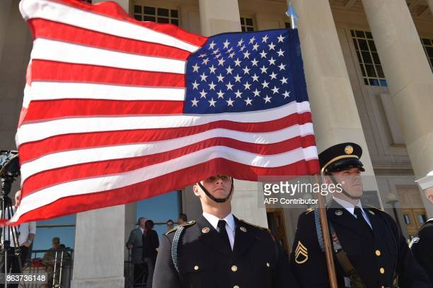 A US flag flies before Secretary of Defense Jim Mattis hosts an enhanced honor cordon welcoming Florence Parly minister for the Armed Forces France...