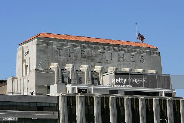 A flag flies halfstaff on top of the Los Angeles Times building April 23 2007 in Los Angeles California The Times announced today that it will offer...