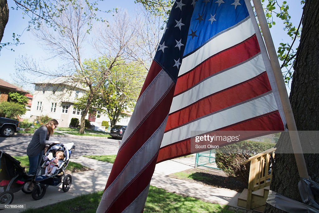 A flag flies outside a polling place on May 3, 2016 in Whiting, Indiana. Indiana voters are casting ballots today to decide Republican and Democrat presidential nominees.