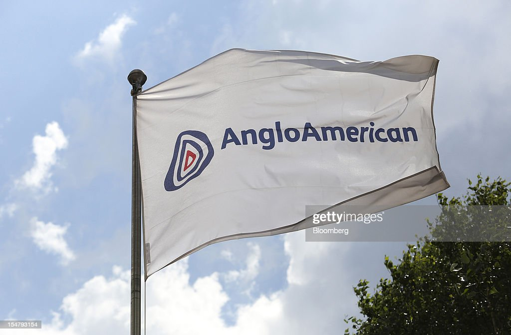 A flag flies outside the offices of Anglo American Plc in the Marshalltown district of Johannesburg, South Africa, on Friday, Oct. 26, 2012. Anglo American Plc Chief Executive Officer Cynthia Carroll , the first woman, external hire and non-South African to hold the job, will quit after Anglo lost $14 billion in value in the more than five years she was in charge. Photographer: Chris Ratcliffe/Bloomberg via Getty Images