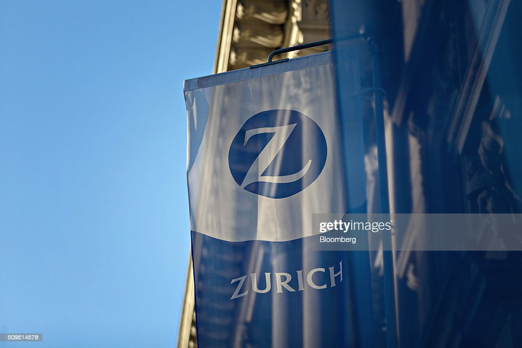 A flag flies outside the Zurich Insurance Group AG's headquarters ahead of the company's full year results news conference in Zurich, Switzerland, on Thursday, Feb. 11, 2016. Zurich Insurance reported a worse-than-expected loss in the fourth quarter as the company makes plans to turn around its unprofitable general insurance unit. Photographer: Michele Limina/Bloomberg via Getty Images