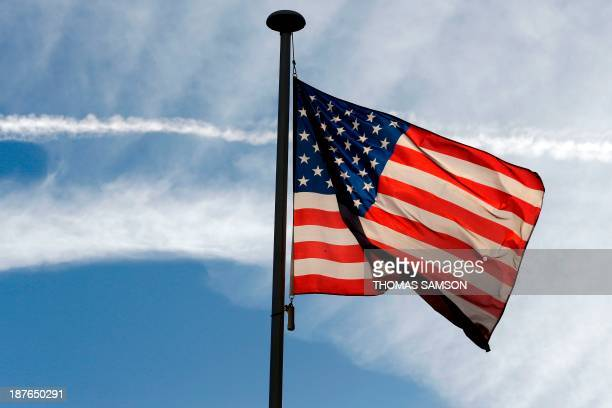 A US flag flutters at The Lafayette Escadrille Memorial of MarneslaCoquette east of Paris on November 11 2013 AFP PHOTO / THOMAS SAMSON